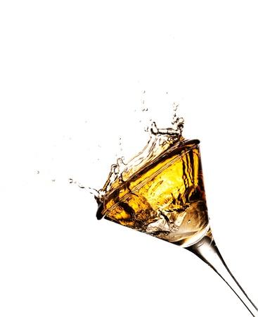 golden cocktail splash against a white background photo