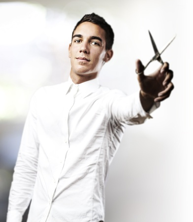 portrait of handsome young man with scissors in a house Stock Photo - 10383628