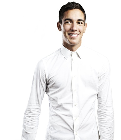 portrait of young man smiling against a white background Stock Photo - 10383482