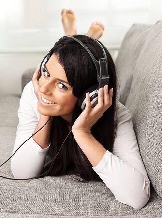 girl listening music on the sofa  photo