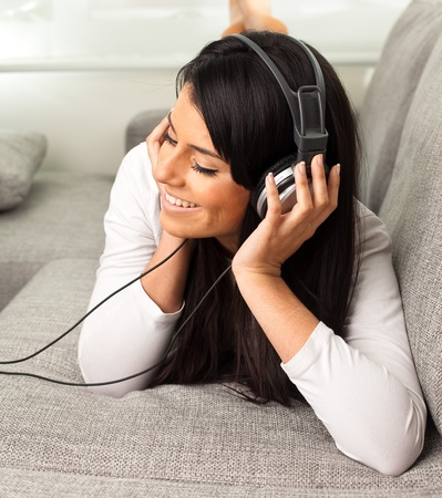 girl listening music on the sofa  Stock Photo - 10383391