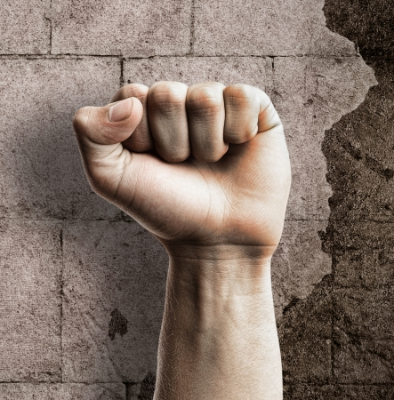 fist fight: strong punch fist against a grunge background