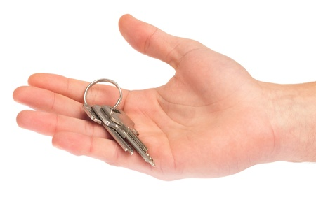 hand holding a key on a white background photo