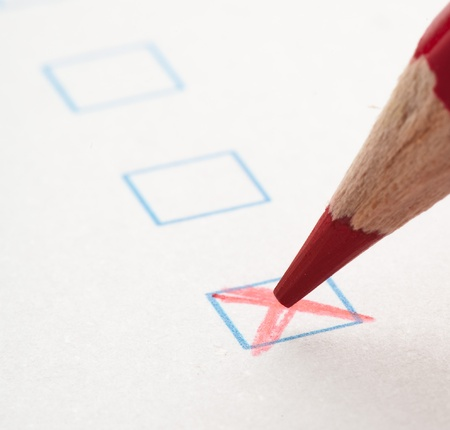 test check box and red crayons, closeup photo Stock Photo - 10382376