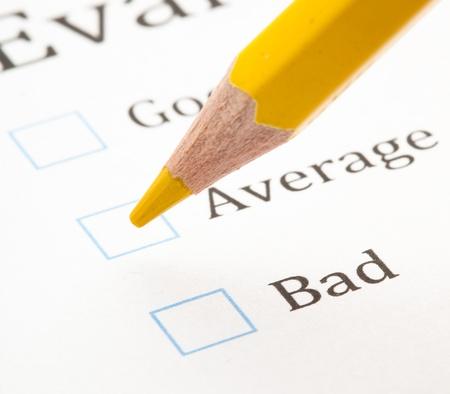 average woman: evaluation test, mark on check box closeup Stock Photo