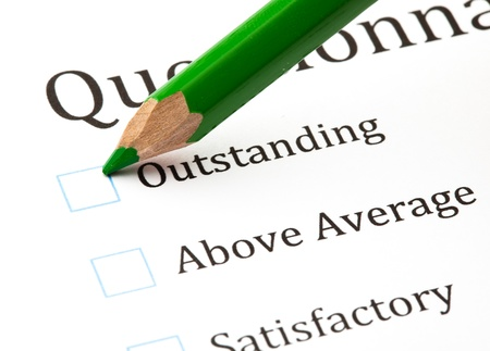 unsatisfactory: questionnaire check boxes and green crayon closeup