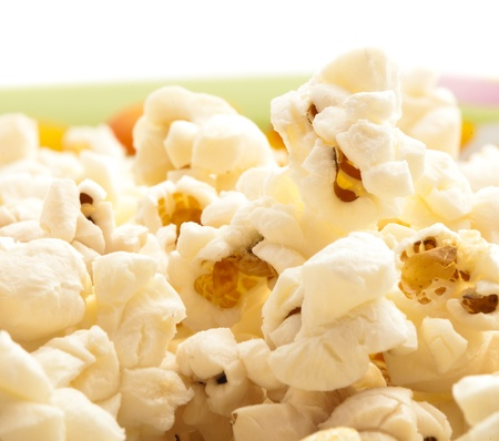 pop corn on a bowl, extreme closeup photo photo
