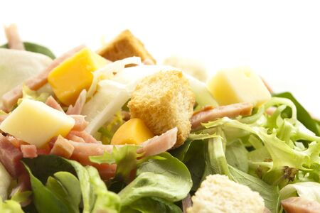 lettuce, ham and cheese salad on white photo