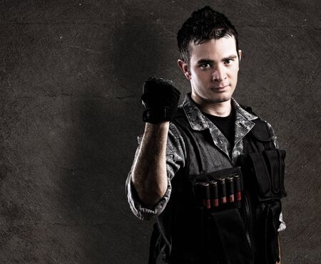 military draft: young soldier against a grunge wall Stock Photo