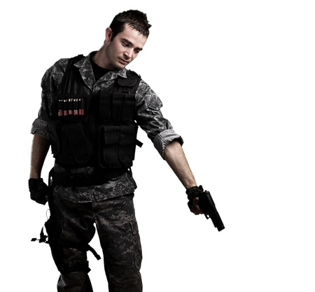 war crimes: young soldier pointing to the ground on a white background