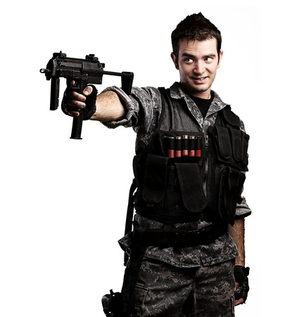 portrait of young soldier smiling with a rifle against a white background Stock Photo - 10550703