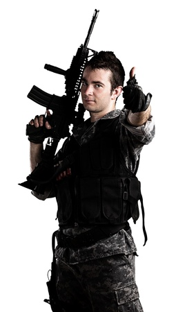 young soldier with urban camouflage on a white background photo