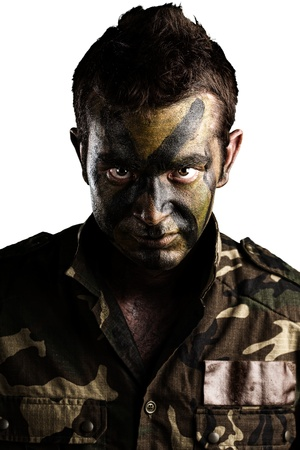 armed forces: young soldier face with jungle camouflage paint on white background