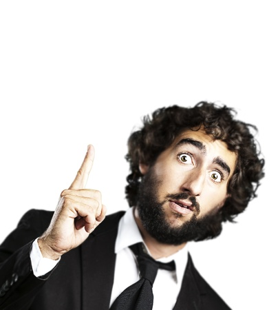 man pointing up: portrait of young business man pointing up against a white background