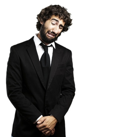 portrait of young business man with suit crying against a white background Stock Photo - 10555386