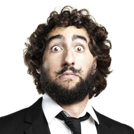 crazy man: portrait of young man face afraid against a white background