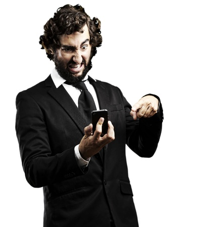 portrait of young business man angry with the technology against a white background photo