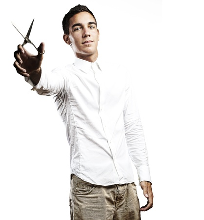open shirt: portrait of young man with metal scissors on blue background Stock Photo