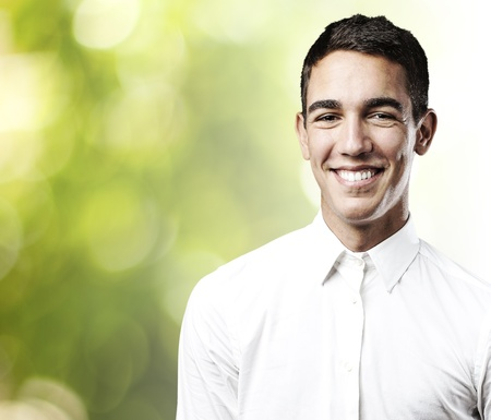 portrait of a young man smiling at park photo