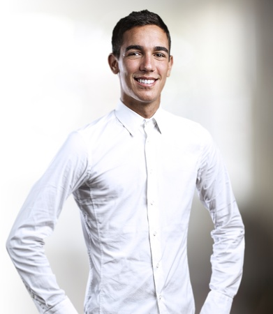 portrait of handsome young man smiling in a house Stock Photo - 10550366