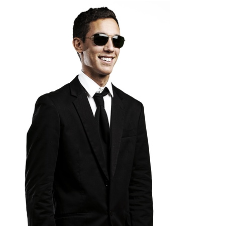 portrait of young man wearing a suit and sunglasses against a white background Stock Photo - 10550386