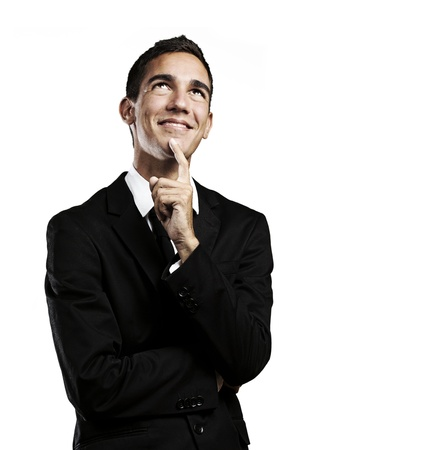 portrait of pensive young business man against a white background  photo