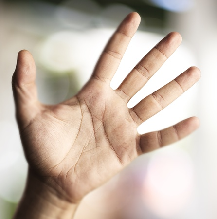 hand symbol against a abstract background photo
