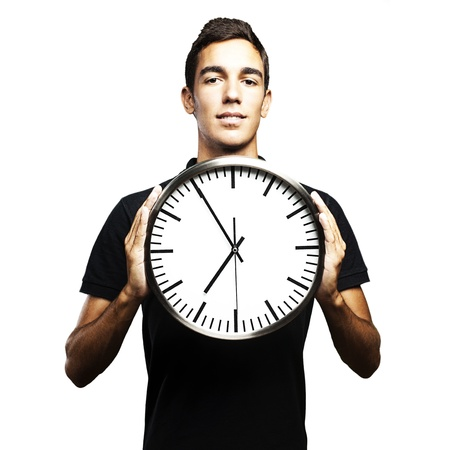 cover background time: portrait of young man holding a clock with his hands over white background Stock Photo