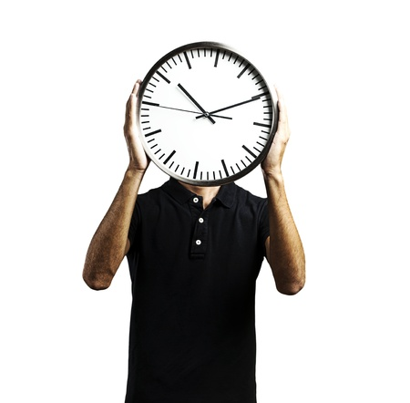 young man covering his face with a clock over white background Stock Photo - 10550315