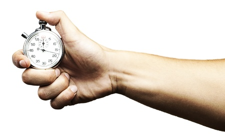 stop time: hand holding a stopwatch against a white background