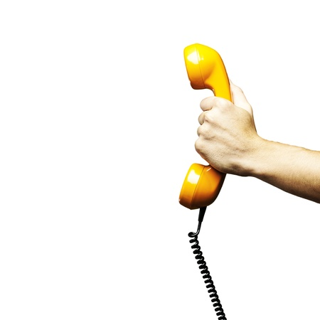 old telephone: Hand holding vintage telephone receiver isolated over white background