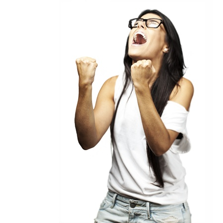 cheering people: portrait of young woman winner against a white background
