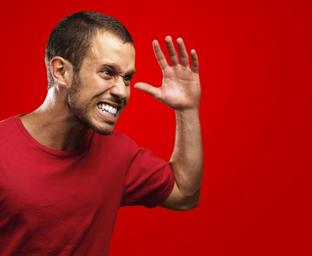 angry young man on a red background Stock Photo - 10550827