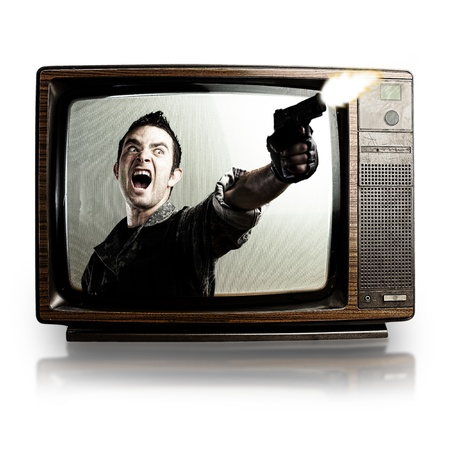 kill: angry tv man shooting a gun, represents violence in tv programs and movies