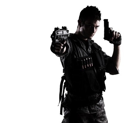 man with gun: young soldier shooting with a pistol on a white background Stock Photo