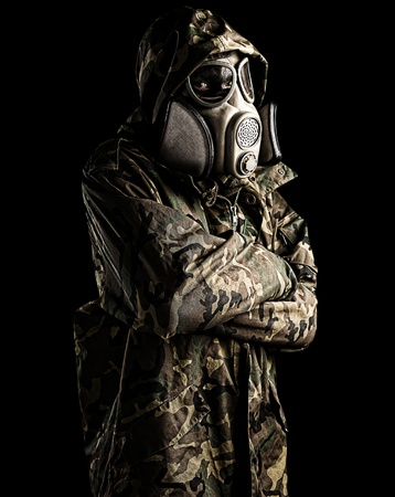 portrait of young soldier with mask against a black background Stock Photo - 10973959