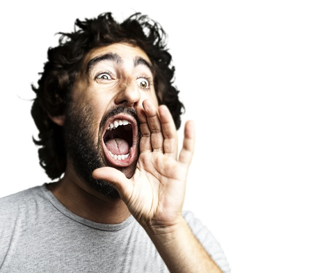 young man shouting against a white background  photo
