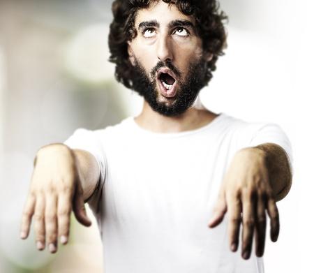 imitating: young man imitating a zombie at living room Stock Photo