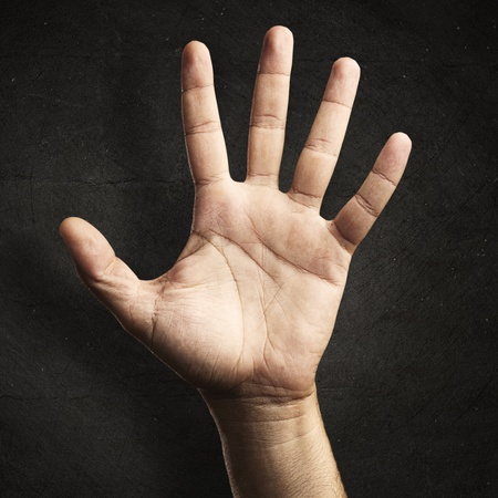 human skin texture: open hand against a grunge background Stock Photo