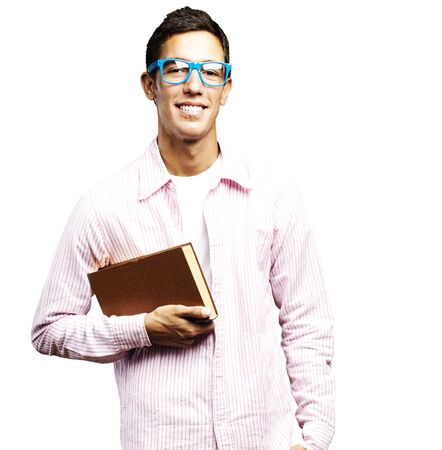portrait of young student holding a book against a white backgroud photo