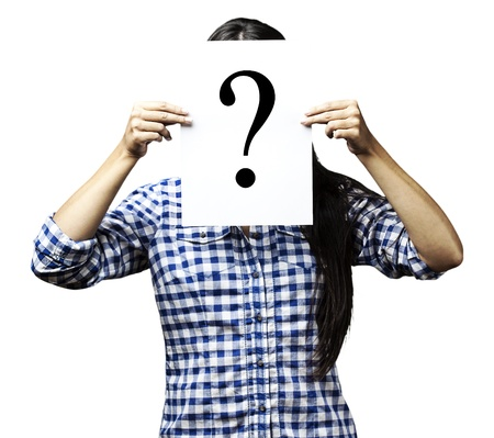 peaking: portrait of woman peaking behind of interrogation symbol over blue background Stock Photo