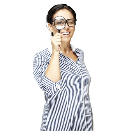 portrait of woman with looking through a magnifying glass against a white background Stock Photo - 11506545