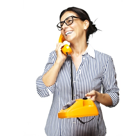 portrait of middle aged woman wearing glasses with vintage telephone on white background Stock Photo - 11506386