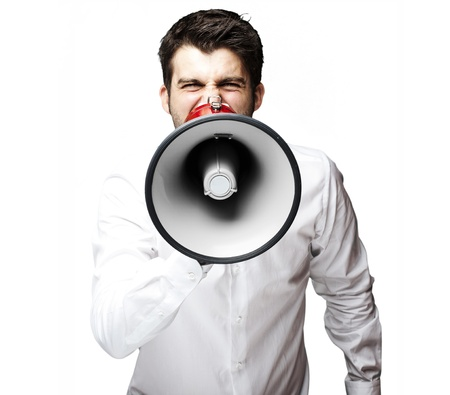 portrait of young man shouting with megaphone against a white background photo