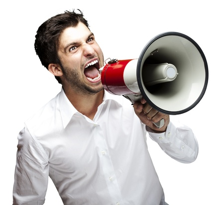 portrait of young man handsome shouting using megaphone over white background