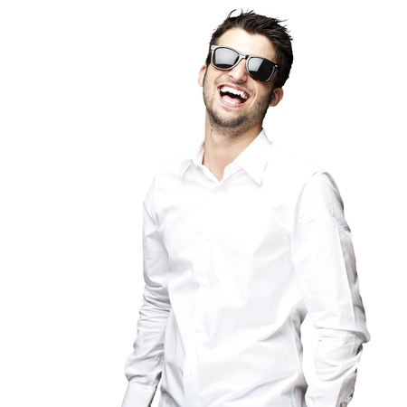 fashionable sunglasses: portrait of a handsome young man enjoying over white background
