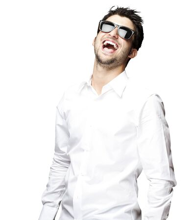 white shirt: portrait of a handsome young man with sunglasses enjoying over white background