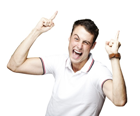 portrait of young man laughing and pointing up over white background photo