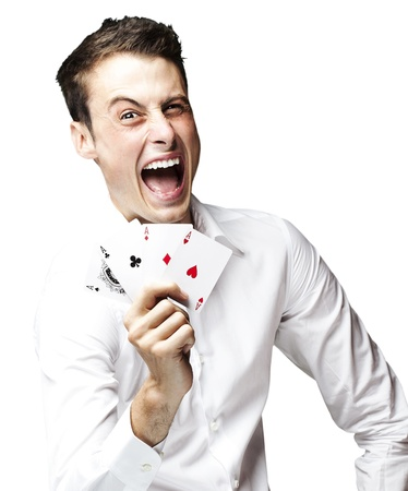 portrait of crazy man showing poker cards against a black background photo