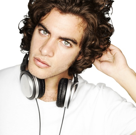 portrait of young man with headphones against a white background photo